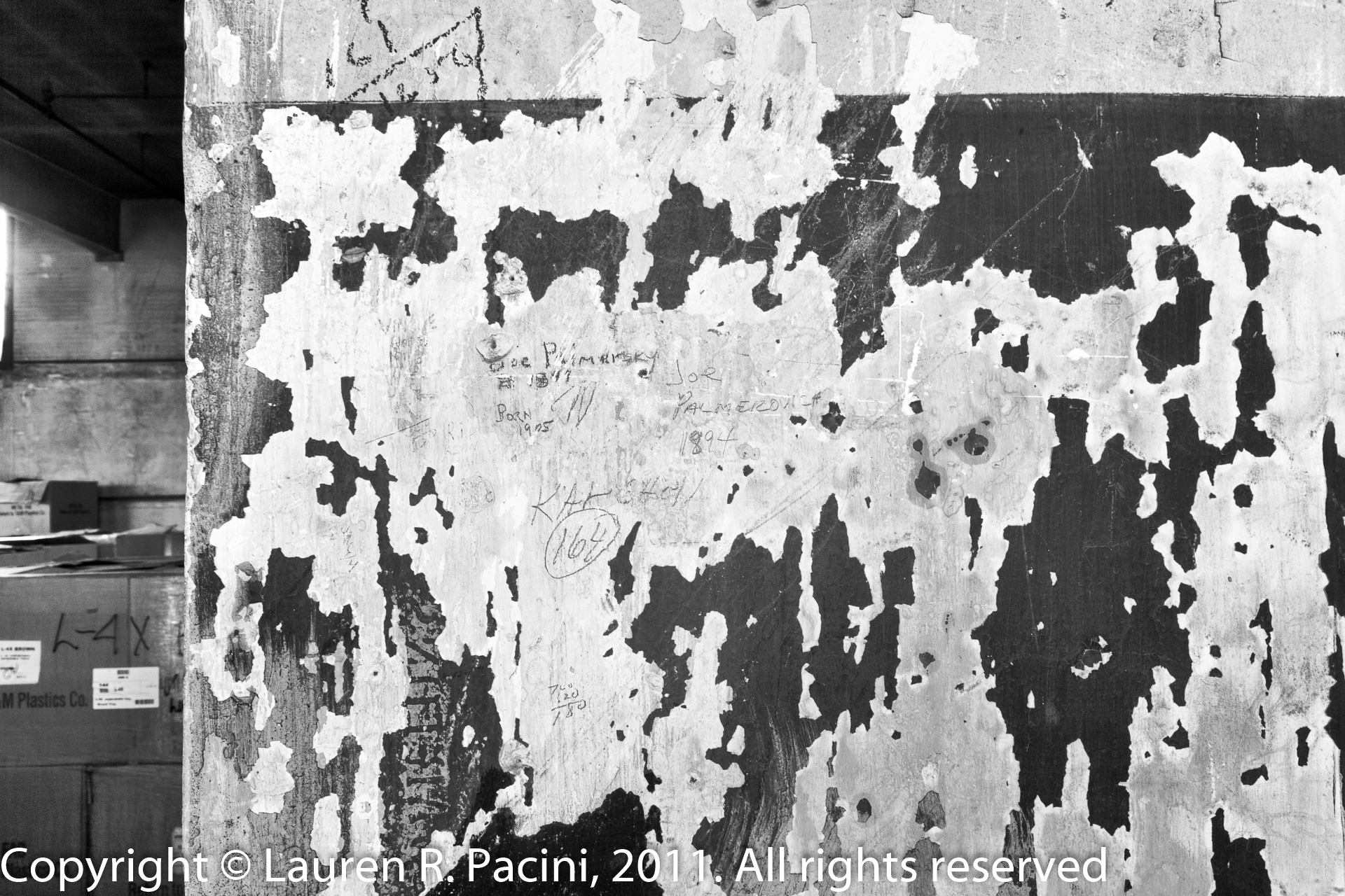 Beneath Peeling Paint is the Names of  Workers at the Winton Factory